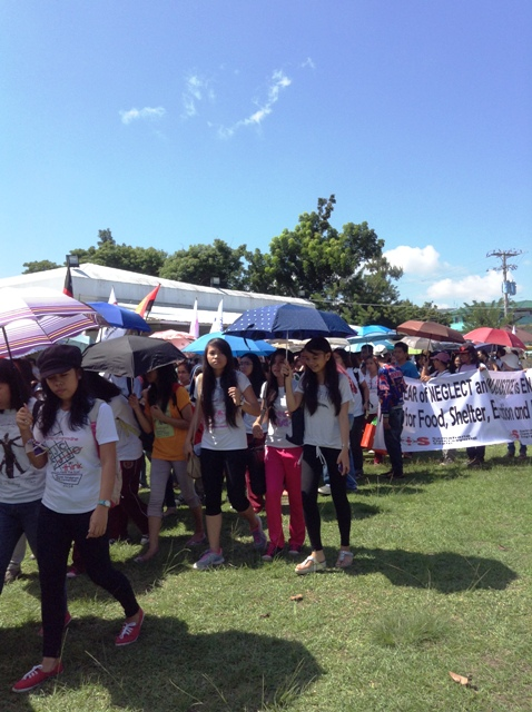 Students from the University of the Philippines Visayas – Tacloban College walk out of their classes to welcome the arriving fleet of protesters at the UP Botanical Garden. (Photo by M. Salamat/ Bulatlat.com)