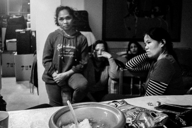 Helen and her fellow domestic workers' main concern is sending financial support to their families in PH. (Photo by Clemente Bautista / Bulatlat.com)