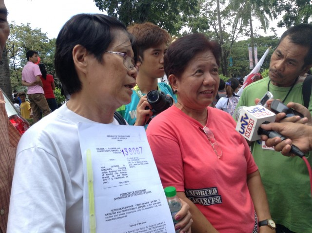 Mothers of disappeared UP students holding a copy of the petition filed before the Court of Appeals after the pre-trial hearing of Palparan in Malolos, Bulacan (Photo by J. Ellao / Bulatlat.com)