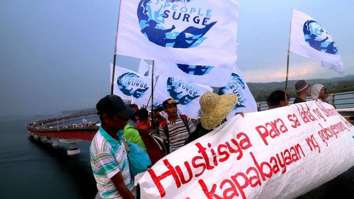 Survivors march across San Juanico Bridge to join Daluyong protests in Tacloban