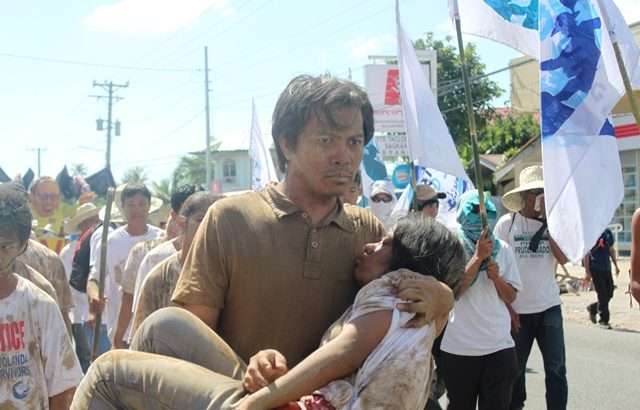 Tens of thousands of survivors gather in Tacloban to demand justice
