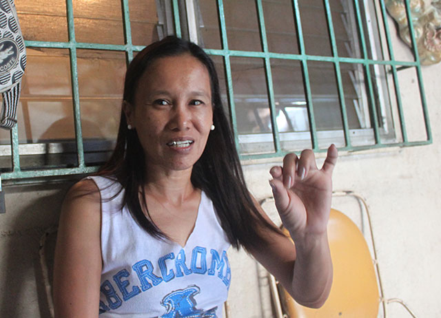 Norie Gonzales, sister of Edison and Rolando Gonzales, who are both on death row, recalls how difficult it is to receive assistance from the Philippine government. (Photo by Ronalyn V. Olea)