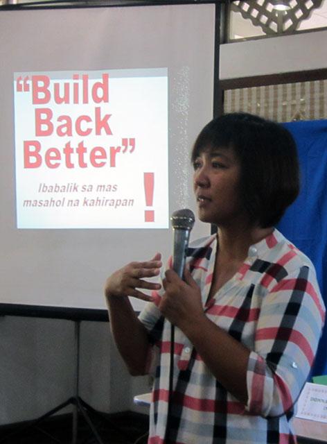 Rosario Bella Guzman of Ibon Foundation presents the think-tank's assessment of government efforts one year after Yolanda. (Photo by Ronalyn V. Olea/ Bulatlat.com)