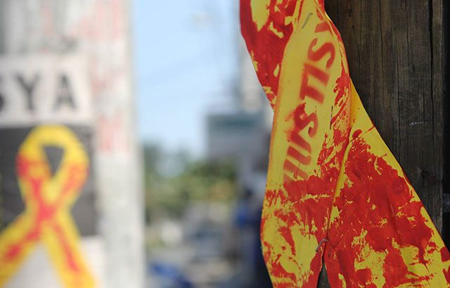 10th year of Luisita massacre | Bloodstained yellow ribbons tied near Aquino's home