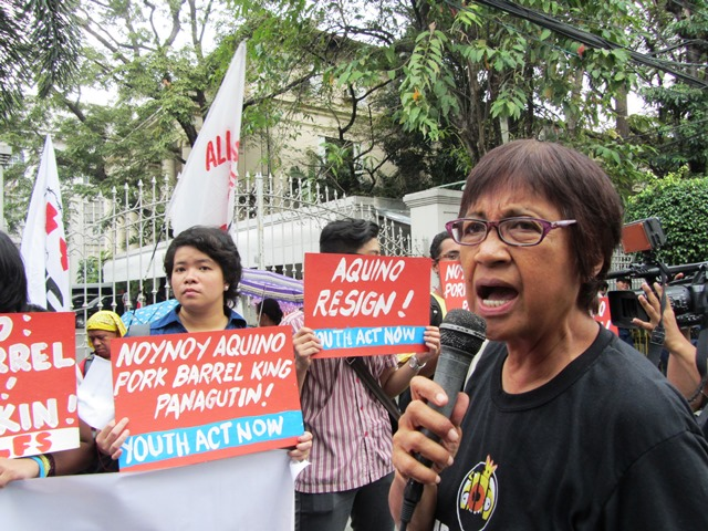 Rita Baua of Bayan enumerates the  millions of DAP funds  that went to 'projects' favored by Pres. Aquino, and to allied senators and congressmen. (Photo by M. Salamat / Bulatlat.com)