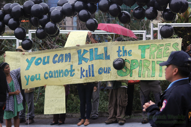 Environmental advocates  stage a rally against SM's proposed expansion plan. The 60 black balloons represent the 60 spirits of trees that were cut by SM Baguio. (Photo by Rocky Ngalob / www.nordis.net)