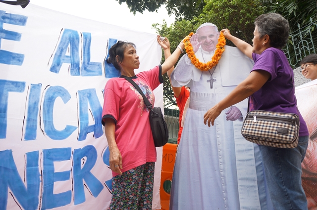 Melcy Torres, mother of political prisoner Miradel, and Felicidad Inandan, aunt of Andrea Rosal, symbolically welcome Pope Francis (Photo by J. Ellao / Bulatlat.com)