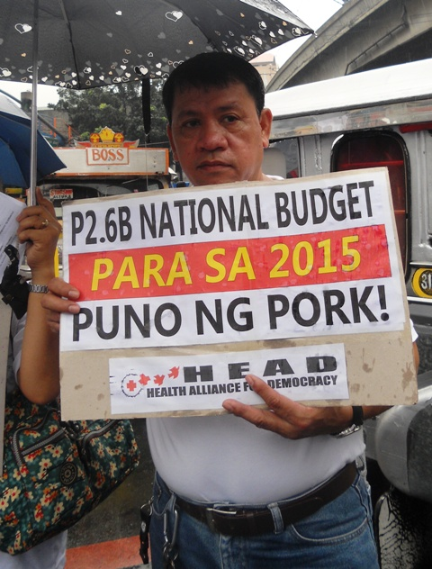 Pedro Angeles, Admin Aide 1 in RITM joins a protest action condemning the non-inclusion of salary increase in the 2015 National Budget in Mendiola, Manila. (Photo by A. Umil/ Bulatlat.com)