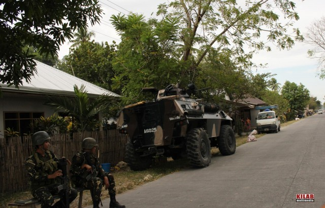 Soldiers and armored personnel carrier posted in Dapyawan village, Datu Saudi Ampatuan, Maguindanao (Photo by Kilab Multimedia)