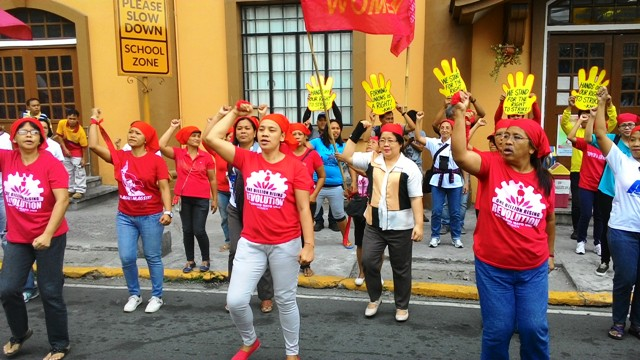 Women from Kilusang Mayo Uno and public school teachers dancing to the One Billion Rising theme song during Feb. 18 protest at the Department of Labor and Employment. (Photo by A. Umil/ Bulatlat.com)