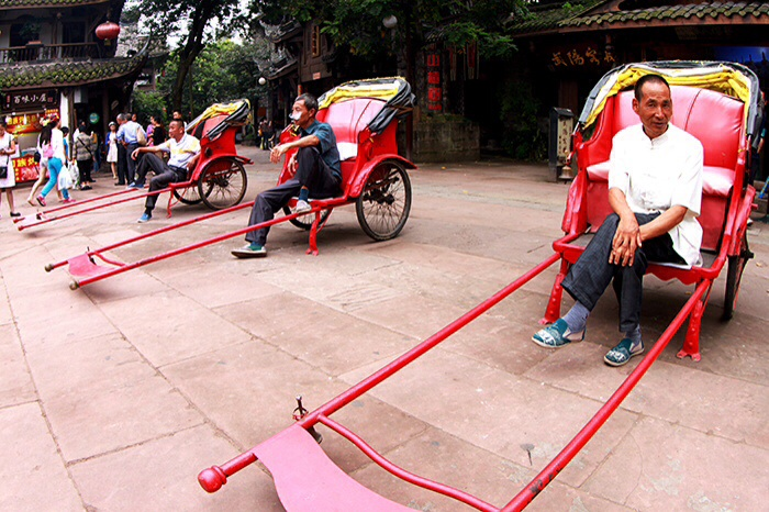 Owing to its economic and scientific advances, China already has very few rickshaws--except in tourism spots, of course. (Ancient Town of Shangli, Sizhuan Province, People's Republic of China)