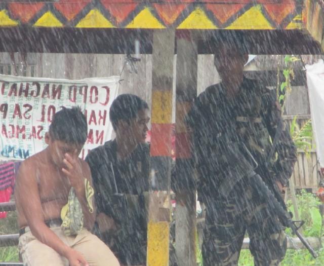 Soldiers at a waiting shed in Bunawan Brook. (Photo by Karapatan-Agusan del Sur)