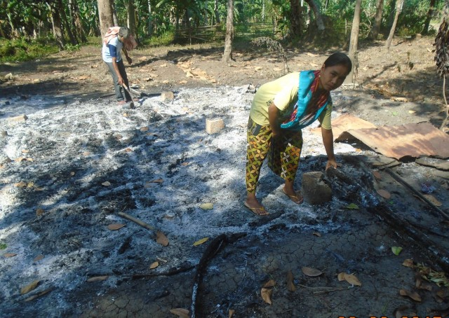 Residents pick through the ashes of their burned homes in Pamalian village, in Shariff Aguak town, Maguindanao. (Photo courtesy of Suara Bangsamoro)