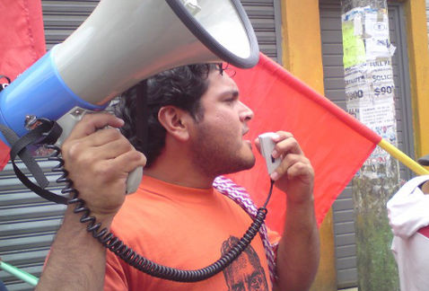 Mexican gov't urged to act on brutal slay of activist
