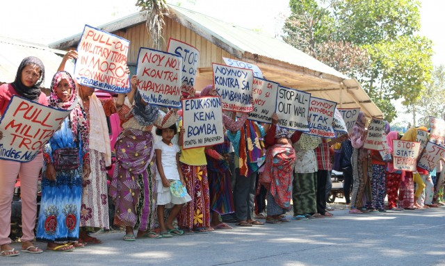 On the 47th year commemoration of the Jabidah Massacre, Moro evacuees in Elian village, Datu Saudi Ampatuan protest in front of the village hall to call for military pullout (Photo by Suara Bangsamoro)