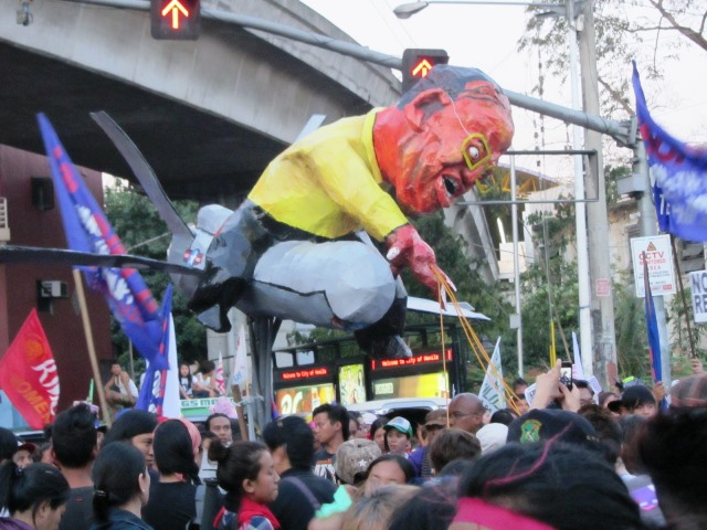 Women gear to bring down President Aquino  depicted here as aboard a drone (Photo by M. Salamat / Bulatlat.com)