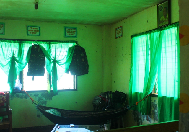 Soldier uniforms inside the barangay office of Nuevo Trabajo. (Photo by A. Umil/ Bulatlat.com)