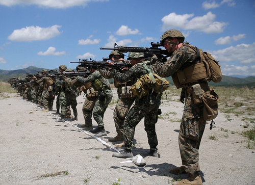 Philippine Marines assigned to 2nd Marine Company, 11th Marine Battalion, and U. S. Marines assigned to Charlie Company, 1st Battalion, 8th Marine Regiment, site in their weapons during close-quarter marksmanship bilateral training May 6, 2014, at Crow Valley, Philippines, for Balikatan 2014. This marks the first day of several bilateral live-fire training evolutions for the exercise. Balikatan is an annual training exercise that strengthens the interoperability between the Armed Forces of the Philippines and U.S. military in their commitment to regional security and stability, humanitarian assistance and disaster relief.  (U.S. Marine Corps photo by Lance Cpl. Joey S. Holeman, Jr./Released)