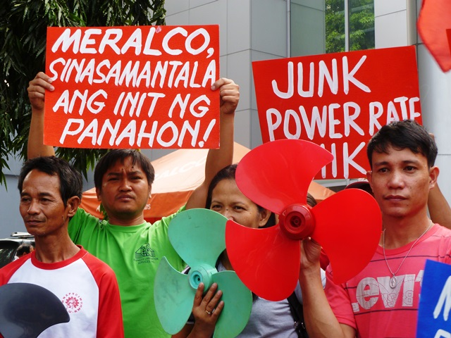 Members of KMU and AWU blast Meralco's taking advantage of summer heat to justify  rate hike (contributed photo, Apr 13, 2014 / Bulatlat.com)