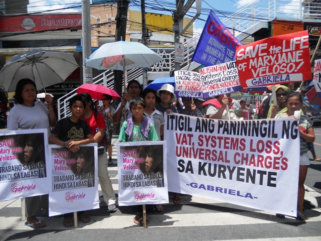 Women call on Aquino to provide local jobs, stop labor export policy