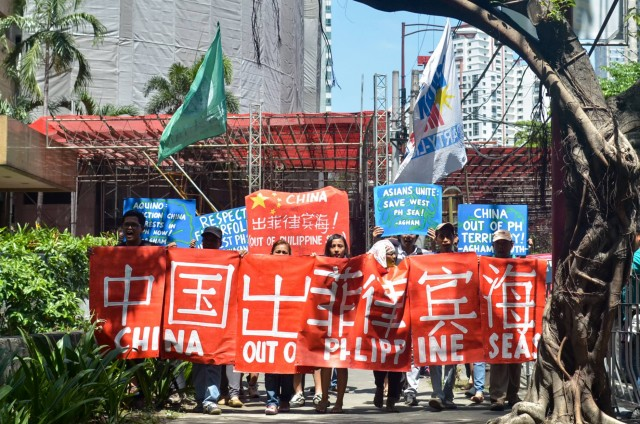 Environmentalists protest outside the Chinese Consulate decrying their ongoing reclamation activities in the West PH Sea. (Photo by L. Manalansan/Bulatlat)