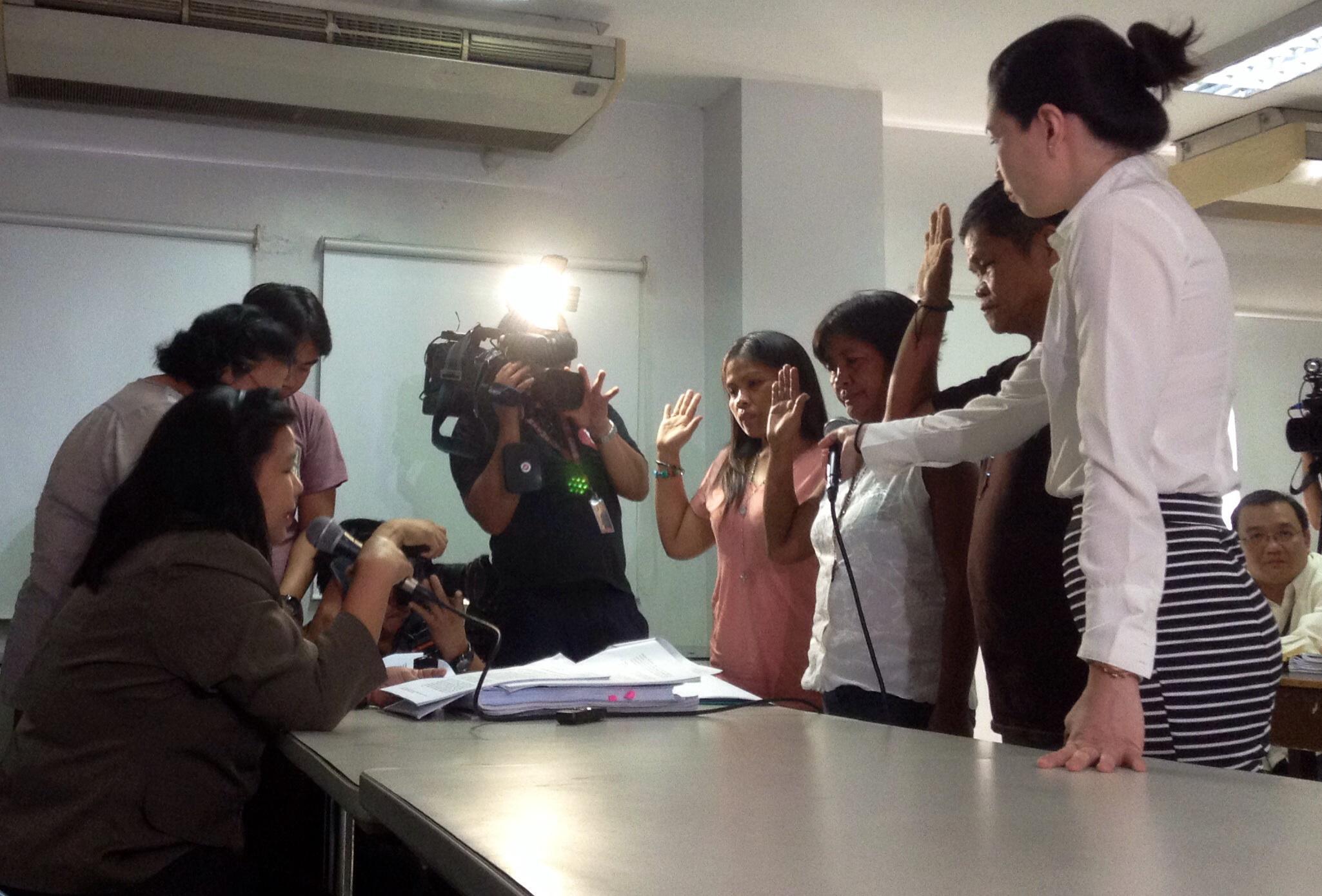 Veloso family submits their reply-complaint before DOJ prosecutor Azarcon. (Photo by J. Ellao / Bulatlat.com)