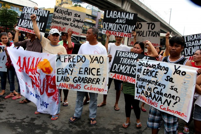 A day before the demolition of their homes, residents hold a protest action. (By Jhun Dantes / Bulatlat.com)