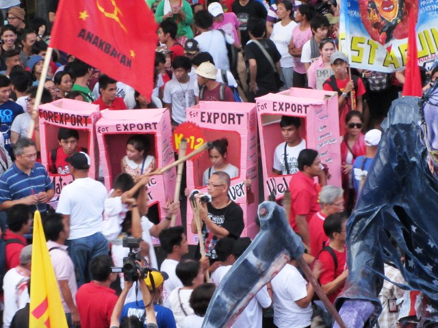 May 1 marchers depict the 'deadly' impact of what they call as cheap labor and labor export policies of the Ph government (Photo by M. Salamat / Bulatlat.com)