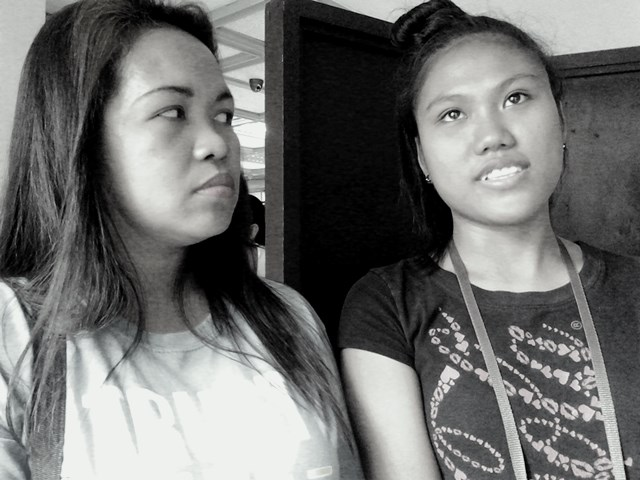 In the picture (L to R) is  Jennifer Novora and Rowena Hije, stepsister and wife, respectively, of 19-year old Suprimo Lugana, one of the youth victims of Kentex factory fire in Valenzuela. (Photo by Marya Salamat May 26, 2015, at NLRC-DOLE / Bulatlat.com)