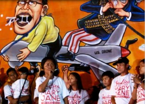 Veloso family led by Nanay Celia speak before May 1 protesters at Mendiola. (Photo grabbed from Bulatlat.com video)