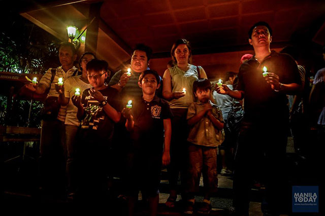 Talents of GMA-7 and their families light candles against contractual labor, June 3 at the Sacred Heart Parish. (Photo by Manila Today)