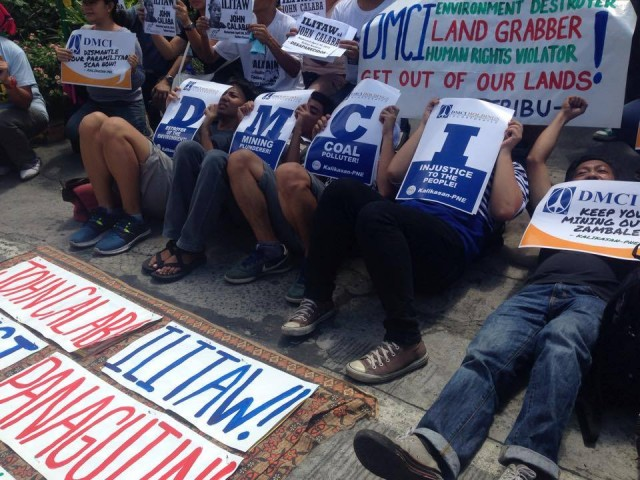 "Protesters stage a ""die in"" in front of the DMCI office. (Photo by B. Catli/Bulatlat,com)"