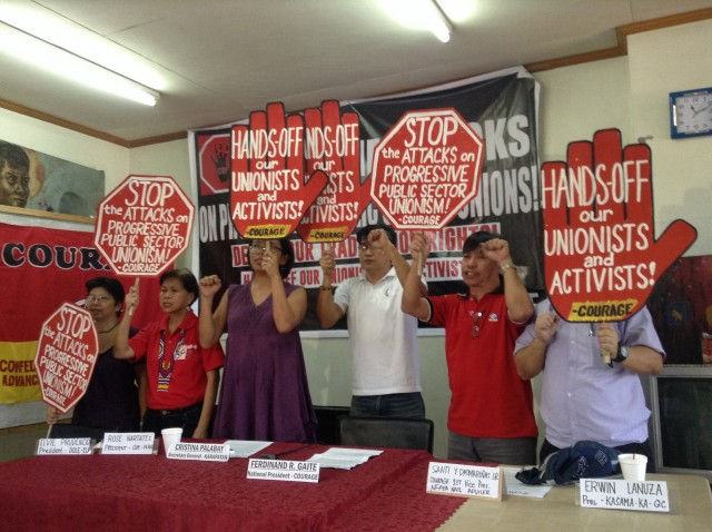 """Hands off our unionists and activists,"" government employees chant. (Photo by J. Ellao / Bulatlat.com)"