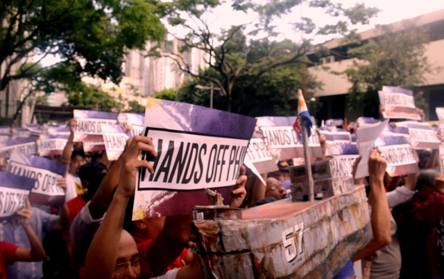 'Filipinos must face 2 big bullies'