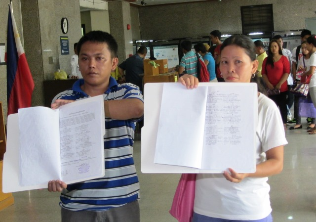 Ammied Rada, coordinator of Justice for Kentex Workers, show the document they submitted to the Ombudsman with signatures of more Kentex survivors and family members. With him is Lea Bersabal, who had worked for 9 years in Kentex. (Photo by M. Salamat)