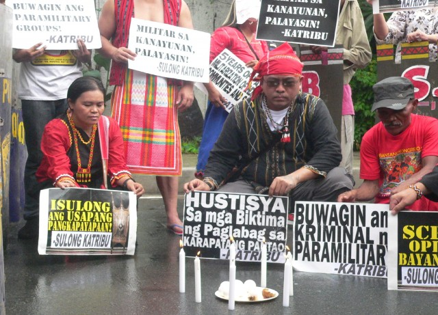 The Lumads offered seven eggs and lit seven candles for the deities in the 'pandiwata' ritual (Photo by D. Ayroso/Bulatlat.com)