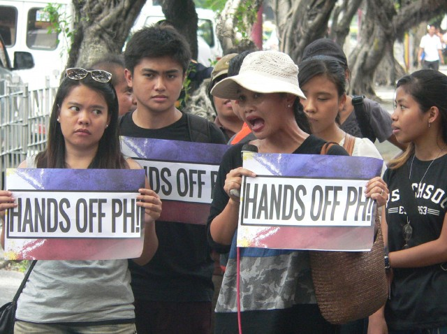 UP Prof. Sarah Raymundo (3rd from left) and the research team join the protest at the Chinese Consulate on July 7. (Photo by D.Ayroso/Bulatlat.com)