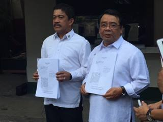 L - R: Bayan Muna Reps. Zarate, Colmenares (Photo grabbed from Bayan Muna Facebook account)
