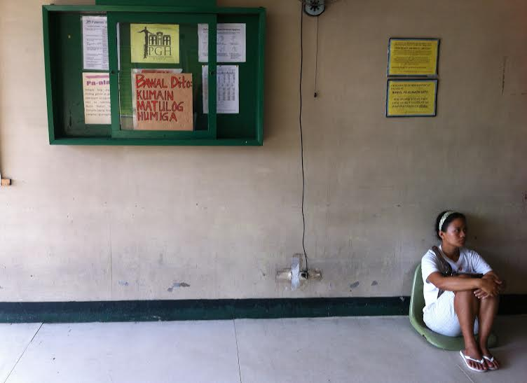 Properly sitting at a proper chair is not included in the list posted at a government hospital. (Philippine General Hospital, Manila)