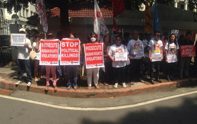 Protesters in front of the DOJ in Padre Faura, Manila (Photo by B.Catli/Bulatlat.com)
