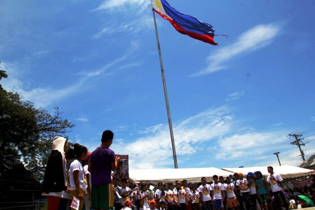 Alcadev students pay tribute to their school director Emerito Samarca at the Guingona Park, Butuan City.