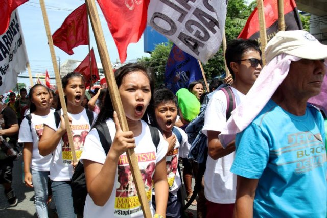 RAGE. High-school students of Alcadev join the funeral march for their school director, from the Capitol Gym to Guingona Park in Butuan City.