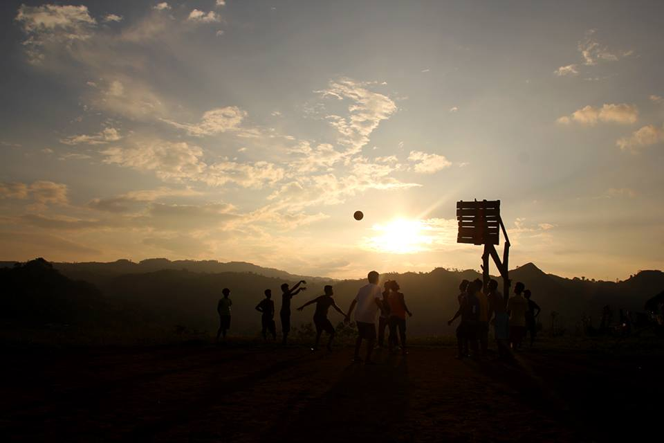 Delegates from the National peace mission plays basketball with Misfi academy pupils as part of the Psychosocial Intervention while the sun is down in brgy White Culaman, Kitaotao, Bukidnon.