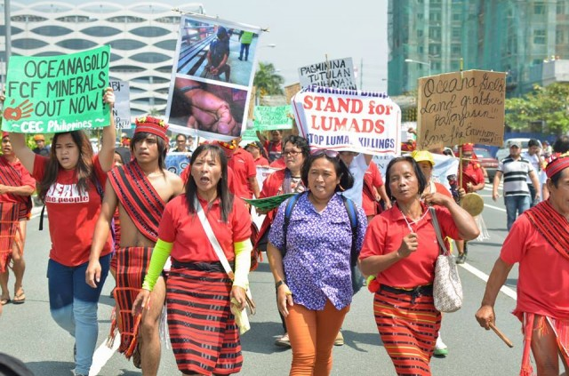 Lumad leader Josephine Pagalan, (3rd from right, in blue) who survived the Magahat-Bagani attack in Lianga, marches with Igorots from Nueva Vizcaya  (Photo by Kalikasan PNE/Bulatlat.com)