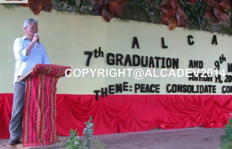 Slain Alcadev head Emerito Samarca, in the 2014 graduation. (Photo from the Facebook account of Alcadev, Inc/Bulatlat.com)