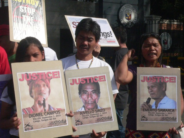 The family of the victims of the Lianga killings join the protest at the gates of Congress on Sept. 8 (L to R:) Sheina, the daughter slain Mapasu leader, Dionel Campos, Manobo leaders Jose Campos and his sister Eufemia Cullamat (Photo by D.Ayroso/Bulatlat.com)