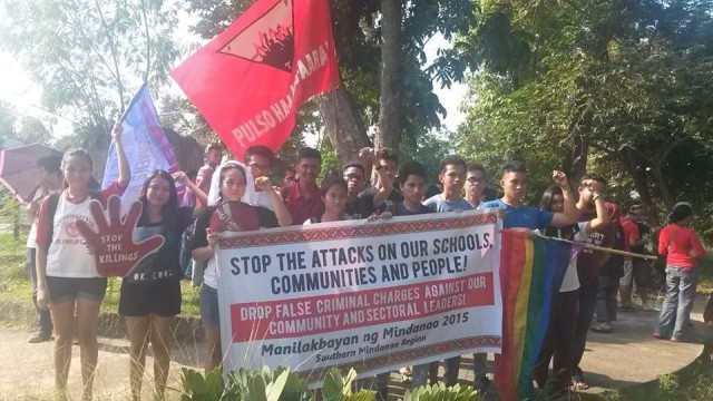 Students of UP Tacloban raise fists in solidarity, as the Manilakbayan pass through Leyte (Photo by Kilab Multimedia)