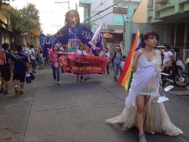 """Lady Justice"" leads the pride march, followed by a 12-foot transgender Higante. (Photo courtesy of K.Yamzon Facebook account)"