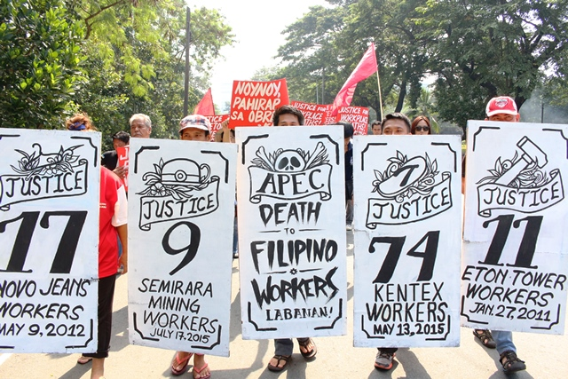 Bulatlat picture workers mourn workplace deaths
