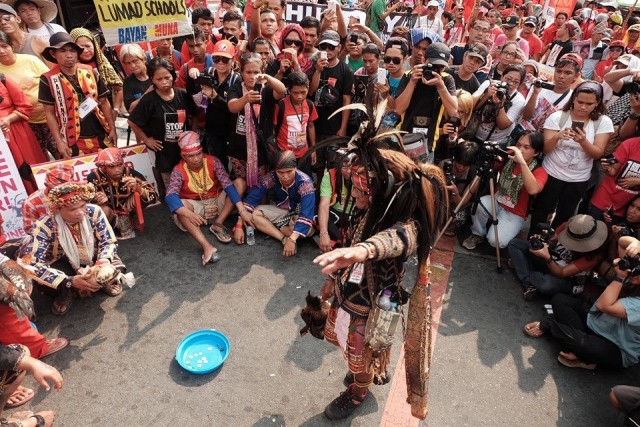 "Lumad leaders perform the ""panubadtubad"" at the foot of Mendiola (Photo courtesy of Manila Today)"